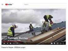 Part of the PfP video, showing SBS operatives installing PV panels